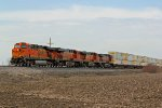 BNSF 7775 Leads a EB stack train.
